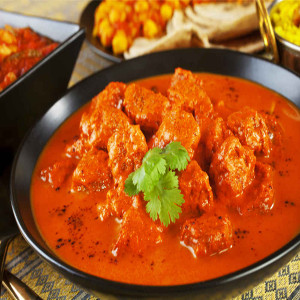 Chiken tikka cooked in a tandoor with a delicately spiced onion and tomato sauce. img Mr. india house restaurant in Palma de Mallorca, spain jalfrezi, Plato de la Carta del Restaurante Hindú Mr. India en Mallorca